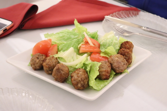 Dibulbul Tibs, marinated meatballs served on a bed of romaine lettuce with diced tomatoes and onions.